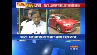 Budget 2013_ SUVs, luxury vehicles to cost more.