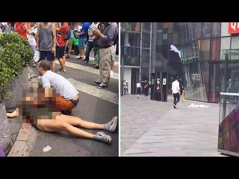 Man Stabbing Woman in Street Sword-wielding Man Stabs Woman