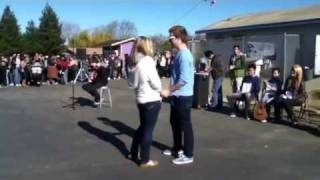 Boy asks girl out by singing