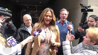"Chrissy Teigen doesn't want 50 Cent to be ""mad"" at her