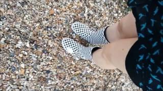 Wading in the harbour barefoot in Vans wellies