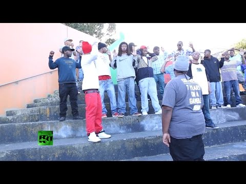 Police bust up filming of rap video to arrest felon with gun