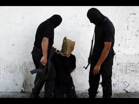"Hamas Gunmen Execute 18 Israeli ""Collaborators"""