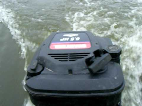 Lawn mower engine powered boat trial run youtube for Outboard motor for canoe
