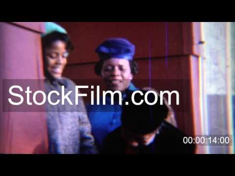 1969: African American women funny formal style colorful hats and earmuffs. CARMEL, INDIANA