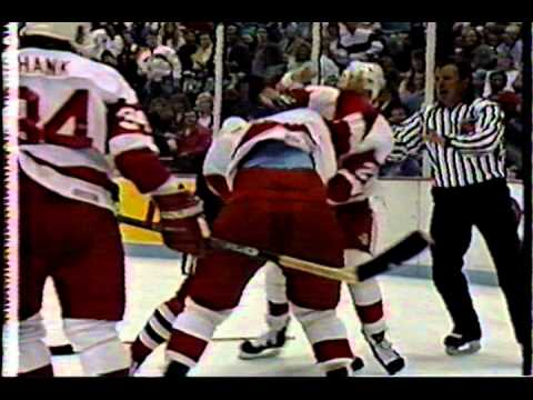 Mike Peluso fights Rick Zombo with Bob Probert third man in, Sep 19, 1990