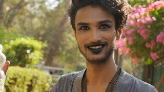 Beautiful Indian Gay Man doing Make up for Mumbai Pride March.Lesbian,Transgender,Bisexual,Woman