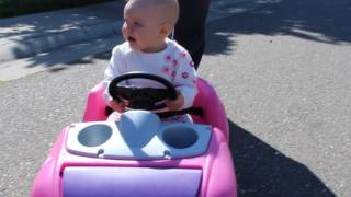 daddy and Amelia ride the new pink car