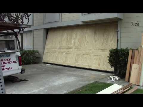 A wood one piece garage door