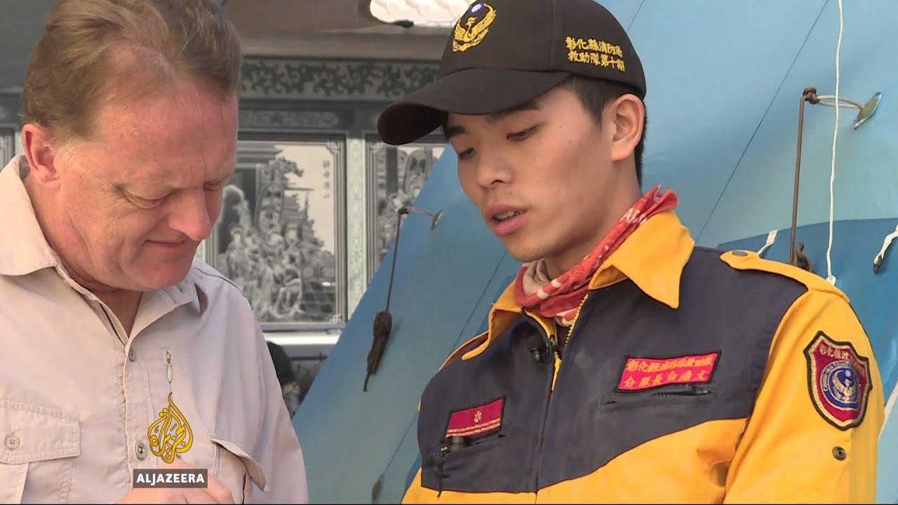 Taiwan quake rescuers pull survivors from debris