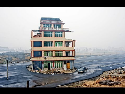 "WE'RE NOT BUDGING! Chinese ""nail houses"" (owners who refuse to be hammered down by development)."
