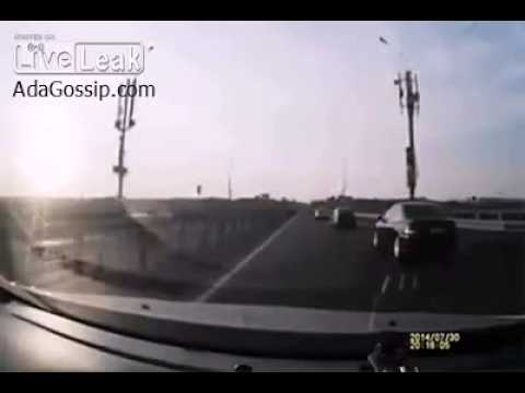 Lucky Motor Bike Rider Lands On Car´s Roof