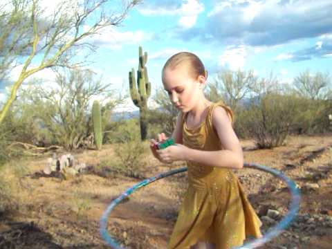 Thumbnail of video Rarities 4: Teagan solves the Rubik's cube while hula hooping in Arizona