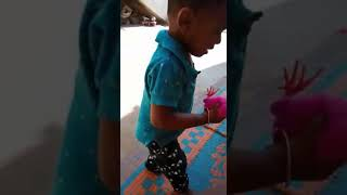 Baby is play with small hen