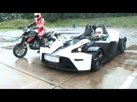 http://issue.imotormag.co.uk iMOTOR puts the KTM X-Bow and the KTM 990 Supermoto against each other in the wet!