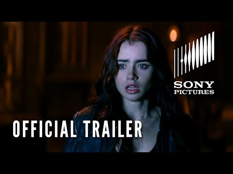 The Mortal Instruments City Of Bones Official Trailer