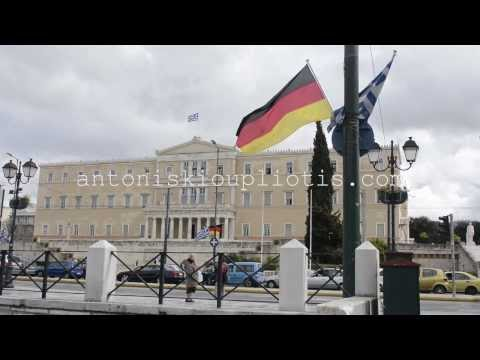 Greek and German flags hanging in front of the parliament.