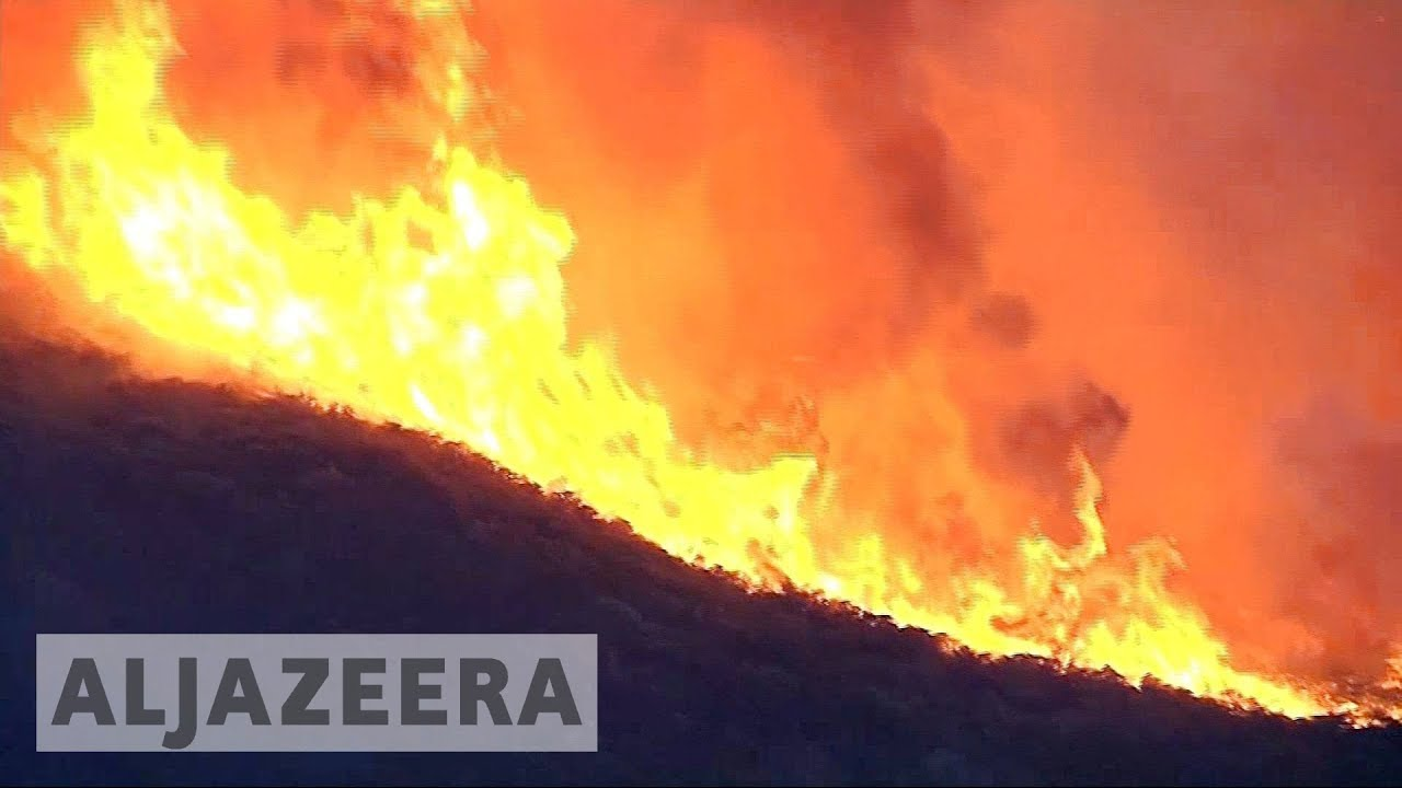 California wildfires continue to rage into second week