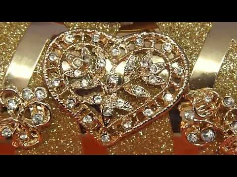 Bolso de mano imitación oro y piedras preciosas