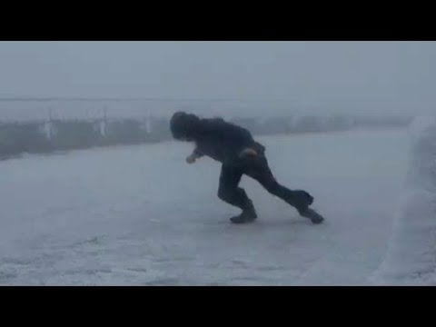 Watch a man take a stroll in 109 mph winds