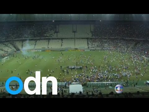 Police fire percussion grenades as fans riot in Brazil's World Cup stadiums