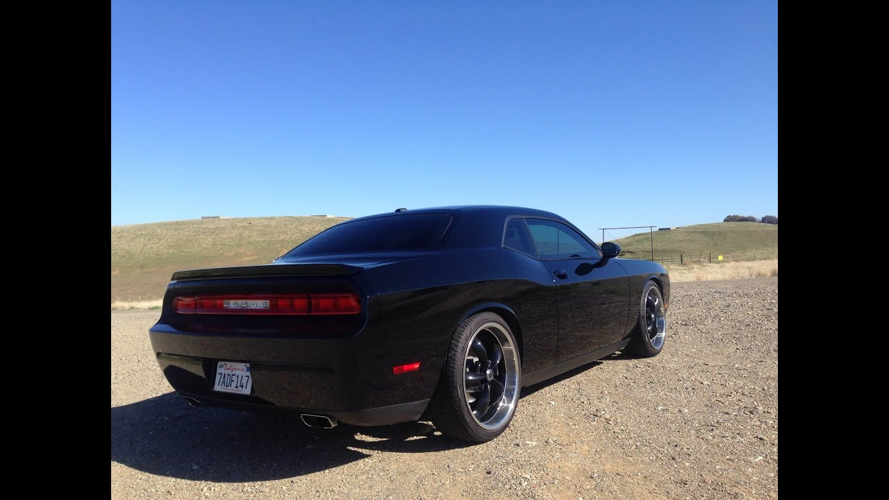 Dodge Challenger lowered on 22 s blacked out