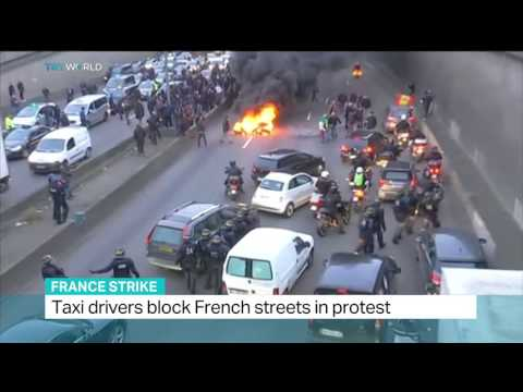 Taxi drivers block French streets in protest