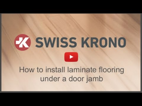 How to install laminate flooring under a door jamb how for How to lay laminate flooring through a doorway