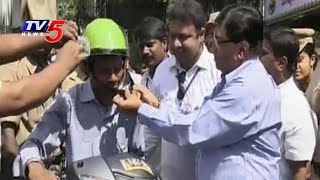 Telangana Motor Driving School Owners Associations Distributes Helmets