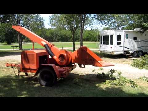 Asplundh wood chipper in action
