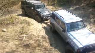 Hummer H2 and Nissan Patrol off road in mud