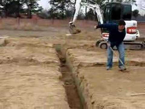 Digging footings youtube for Digging foundation for house