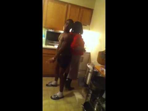 Son twerking on mom in kitchen