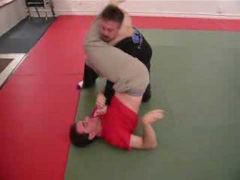Jujitsu spider guard armbar from rubber guard variation Image 1