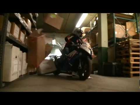"Chris ""Teach"" McNeil stunts BMW S1000RR in Twisted Throttle warehouse.wmv"
