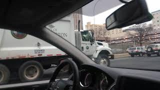 alongside a Wilmington trash truck