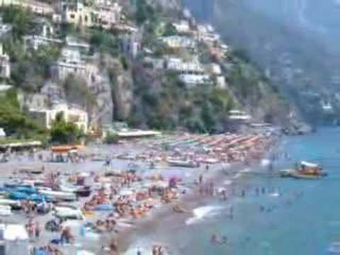 Positano is such a picturesque suburb to seem a theater. Seen by the sea, it appears as a great manger, a fall of degrading motley cottages along the slant.