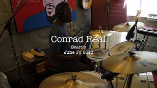 Conrad Real records drums with The Argument