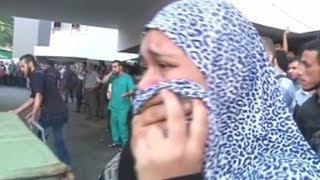 Gaza fighting strikes market, UN school