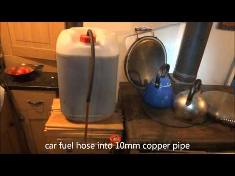 ozzirt waste oil heater in wood stove