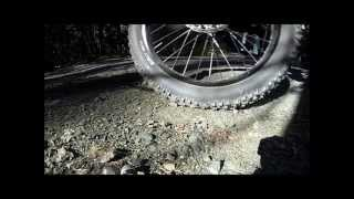 Three different bicycle wheel sets, in a turn, in slow motion.