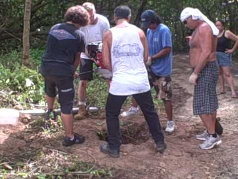 9 26 09 Guam kitesurfing crew digging gate post holes at jeff's. 6th clip