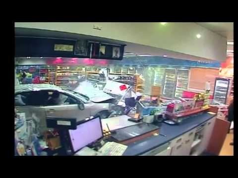 CCTV footage: Car ploughs into service station in Australia