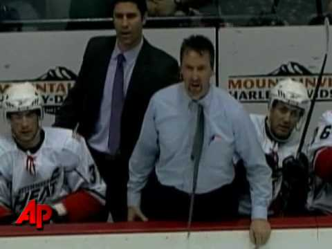 Raw Video: Hockey Coach Breaks Stick in Outburst