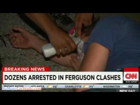 Watch CNN anchors put on gas masks in Ferguson, MO