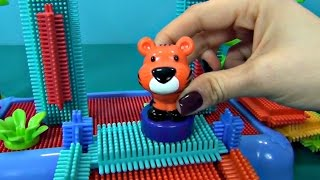 Bristle Blocks in English. Unboxing and building constructor for kids Bristle Blocks in the jungle