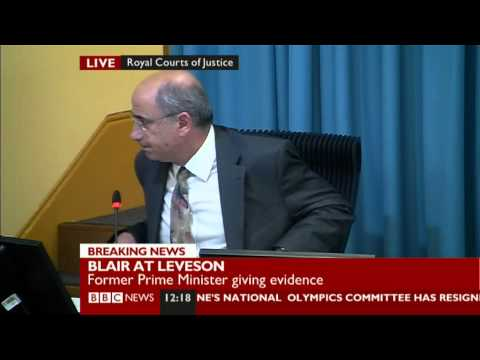 Protester interrupts #Leveson inquiry to accuse Tony Blair of war crimes
