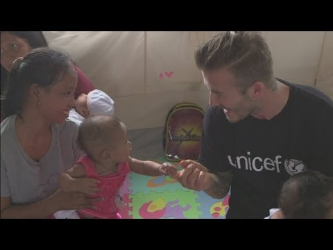 David Beckham plays with cute baby in the Philippines