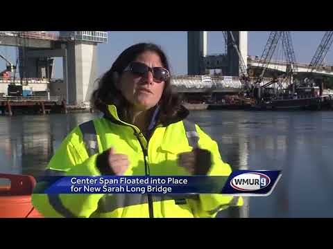 Massive center span floated into place for new Sarah Long Bridge