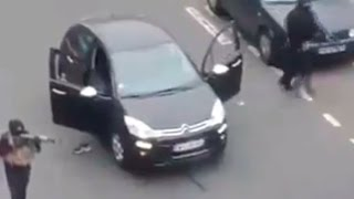 RAW: Charlie Hebdo attackers shoot, then make their getaway by car